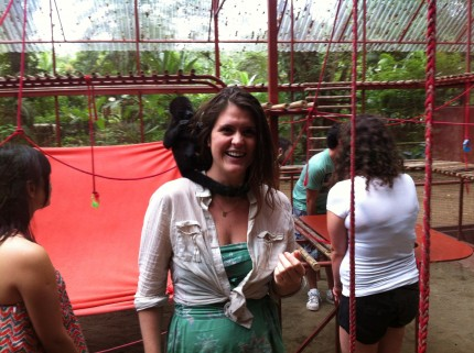Allison goes into the monkey cage at the Jaguar Rescue Center.