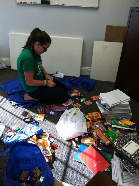 Katie collects and organizes the school supplies collected from her drive.