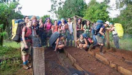 A group of Outward Bound students engage in community service, learning compassion through experience.